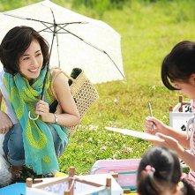 Rokugatsudou no sanshimai: Yo Yoshida con l'ombrellino parasole