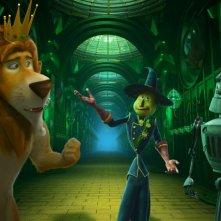 Il magico mondo di Oz: il leone, lo spaventapasseri e l'uomo di latta in una scena del film