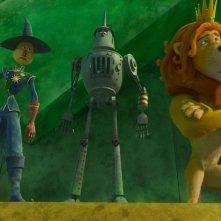 Il magico mondo di Oz: lo Spaventapasseri, l'Uomo di Latta e il Leone codardo in una buffa immagine del film
