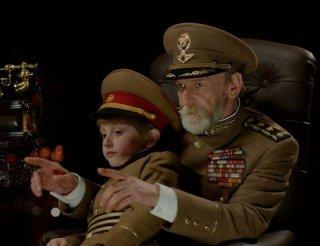 The President: Misha Gomiashvili con il piccolo Dachi Orvelashvili in una scena del film