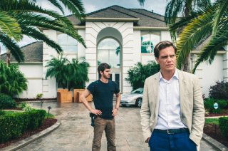 Andrew Garfield e Michael Shannon in 99 Homes