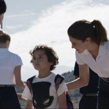 Last Summer: Rinko Kikuchi con Lucy Griffiths e il giovane Ken Brady in una scena del film