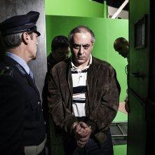 La trattativa: Enzo Lombardo ammanettato in una scena del film di Sabina Guzzanti