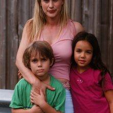 Boyhood: Ellar Coltrane con Patricia Arquette e Lorelei Linklater in una foto promozionale