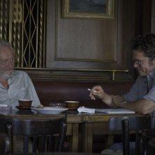 By the Sea: Brad Pitt con Niels Arestrup in una scena