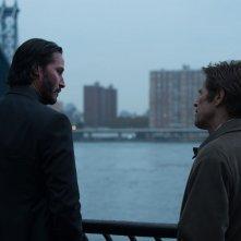 John Wick: Keanu Reeves con Willem Dafoe in un'immagine del film