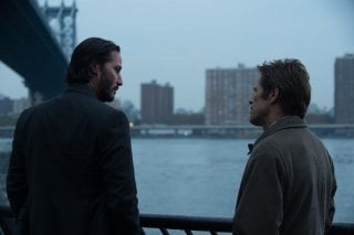 John Wick: Keanu Reeves con Willem Dafoe in un'immagine del film