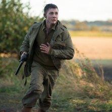 Fury: Logan Lerman in fuga in una scena del film