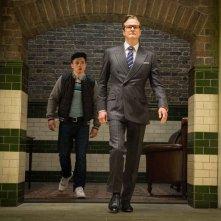 Kingsman: Secret Service, Colin Firth insieme a Taron Egert in un momento del film