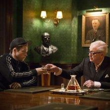 Kingsman: Secret service, Taron Egerton con Michael Caine in una scena del film