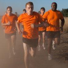 The Fighters - Addestramento di vita: allenamento in spiaggia per Kévin Azaïs in una scena del film