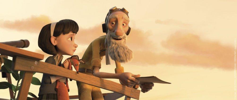 Il Piccolo Principe: l'aviatore e la bambina in una scena del film d'animazione