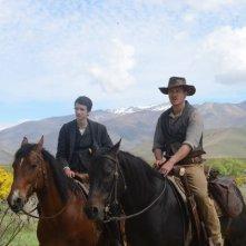 Slow West: Michael Fassbender e Kodi Smit-McPhee in una scena