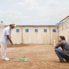 La regola del gioco: Jeremy Renner con Andy Garcia in una scena del film