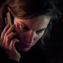Lace Crater: Lindsay Burdge al telefono in una scena del film