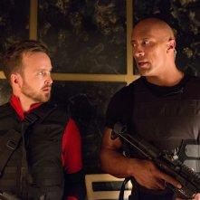 Una spia e mezzo: Aaron Paul e Dwayne Johnson in una scena del film