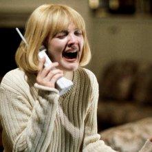Drew Barrymore nella celebre sequenza iniziale di Scream