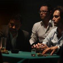 Il vincente: Luca Magri sul tavolo da gioco in una scena del film