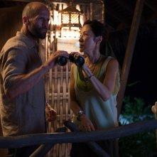 Mechanic: Resurrection, Jason Statham e Michelle Yeoh in una scena del film