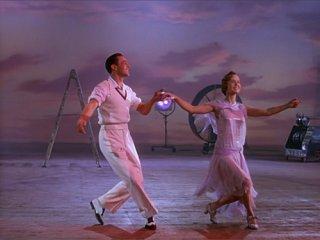 Debbie Reynolds e Gene Kelly in Cantando sotto la pioggia