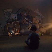 Incarnate - Non potrai nasconderti: David Mazouz di spalle in una scena del film