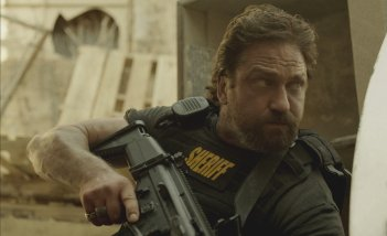 Den of Thieves: un primo piano di Gerard Butler in azione