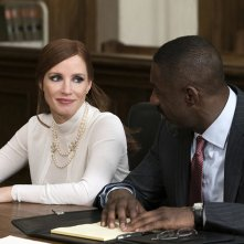 Molly's Game: Jessica Chastain e Idris Elba in un momento del film