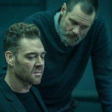 Dark Crimes: Jim Carrey e Marton Csokas in una scena del film