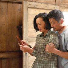 So Long, My Son: Yong Mei e Wang Jingchun in un'immagine del film